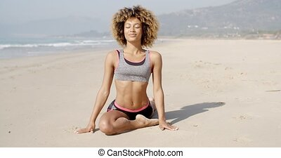 Healthy Young Woman Practices Yoga Outdoor - Slender fit...