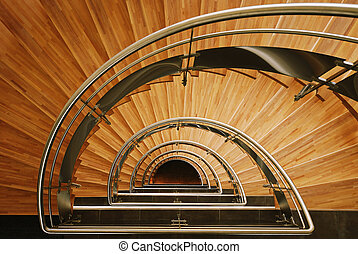 Wooden staircase - Down view of a semi elliptical interior...