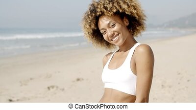 Portrait Of Girl Smiling On Beach - Young african american...