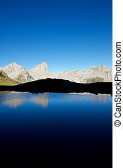 Pyrenees - Peaks reflected in Ansabere Lake Lescun Cirque...