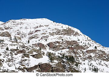 Pyrenees - Snowy peak in Aspe Valley, France.