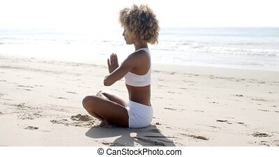 Woman Meditation On Beach - Young woman practicing morning...