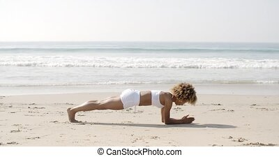 Girl Working Out On The Beach