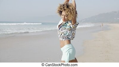 Girl Jumping With Joy On The Seashore - Happy playful woman...