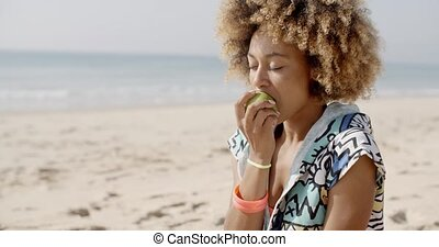 Woman Eating A Green Apple - Healthy young woman biting...