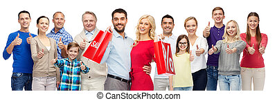 happy people with shopping bags showing thumbs up - gesture,...