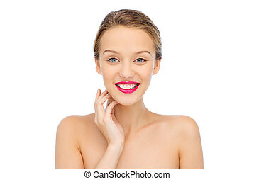 smiling young woman with pink lipstick on lips