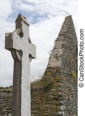 celtic cross and church ruins - old celtic cross head stone...