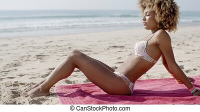 Beautiful Woman Sunbathing On A Beach