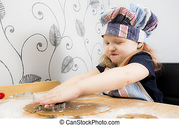 Child making Christmas cookies