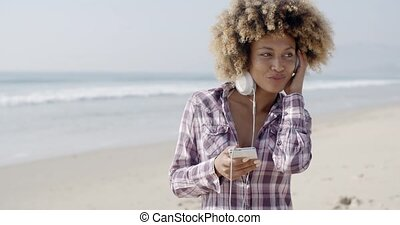 African American Girl Listening To Music - Portrait of a...
