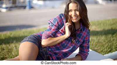 Girl Relaxing On Bench In The Park