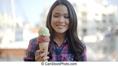 Girl Eating Ice Cream - Gorgeous woman eating an ice cream...
