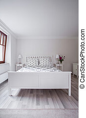 White and tasteful furnitures in a bedroom