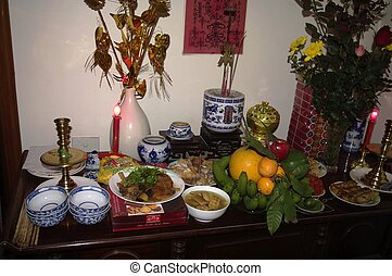 Ancestral altar for Tet - From left to right: Chopsticks...