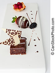 Three Small Gourmet Desserts on a White Tray