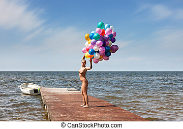 naked woman with colorful balloons