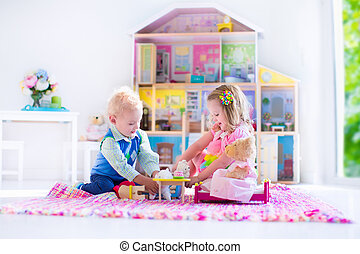 Kids playing with stuffed animals and doll house - Kids...