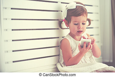child little girl with telephone smartphone - child little...