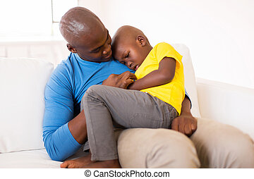 african american father comforting his son - african...