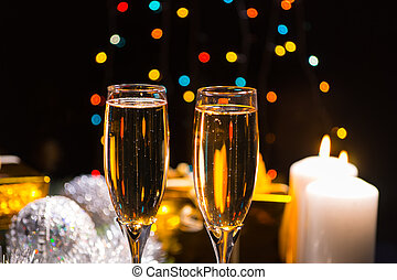 Candlelight champagne Christmas background with two glasses...
