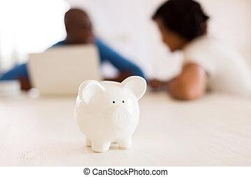piggybank - closeup of a piggybank with african couple on...