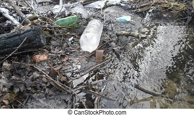 Brook littered with household wastes - Water in brook...