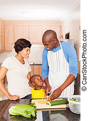 african american family of three cooking