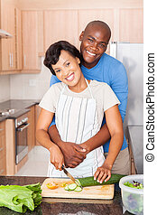black couple cooking together - beautiful black couple...