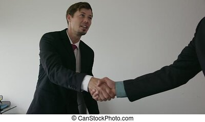 4 Business People Shaking Hands At Office Meeting With...