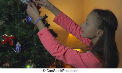 Little Girl Decorate Chrismass Tree