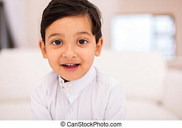 little muslim boy at home