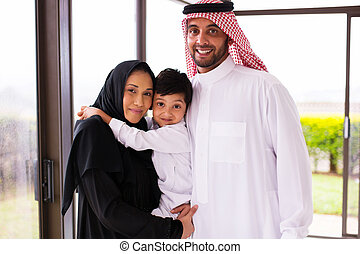 young muslim family of three - portrait of happy young...