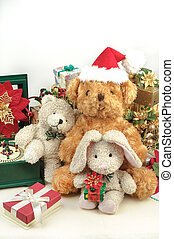 Christmas teddy bear with gifts and friends