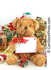 Christmas teddy bear with gifts and white space card