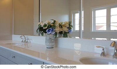 Motorized dolly shot of bathroom interior in a luxurious...
