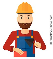Bricklayer with spatula and brick - A smiling hipster...