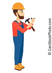 Man hammering nail - A hipster constructor with the beard...