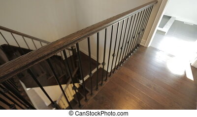 Motorized dolly shot of wooden stairs in a new home