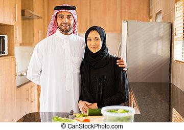 muslim couple in kitchen - happy muslim couple in kitchen