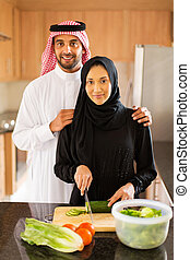 Arabian couple in kitchen