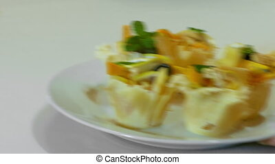 Waiter Puts A Plate With Tartlets - Waiter Puts Delicious...