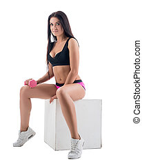 Training with dumbbells. Attractive model posing