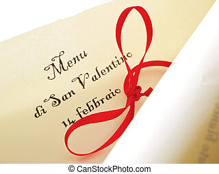 Valentine\'s day unrolled parchment with red ribbon.