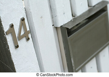 number 14 sign for home with mailbox