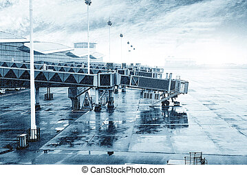 Rain Airport - Airports in heavy rain outside the window,...