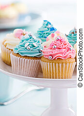 Afternoon tea - Assortment of colorful cupcakes on a...
