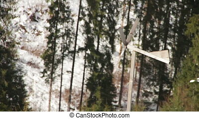 Wooden windmill spinning in the wind in winter. - Old...