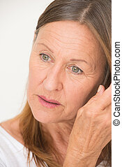 Thoughtful relaxed mature woman portrait - Portrait...