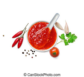 red hot chilli sauce isolated on a white backgroundTop view...